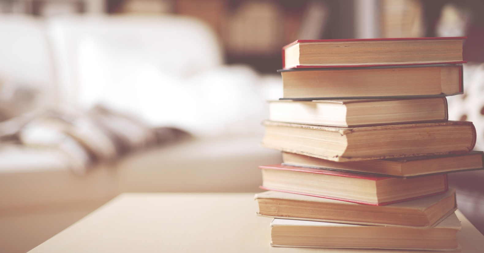 stack of old books in home interior